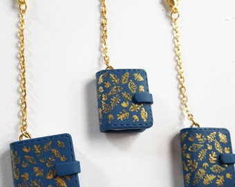 Kikki k teal with gold leaves