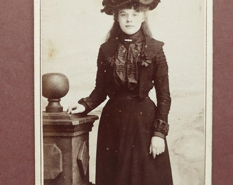 Carte-de-visite, antique, a young lady with a large hat, and an outfit trimmed with braid & ribbon bows. Charles Jones, Hull. c late 1890's