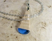 Blue teardrop wood resin fusion pendant. Translucent blue resin and maple wood pendant. All natural UVpoxy.