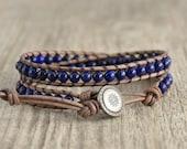 Dark blue boho chic leather wrap bracelet. Beaded lapis lazuli jewelry