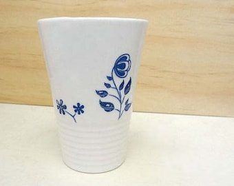 Ceramic coffee cup with flowers. Handmade porcelain tumbler for tea or coffee. Floral cup. Coffee drinker.