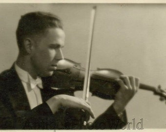 Young man playing violin antique music photo