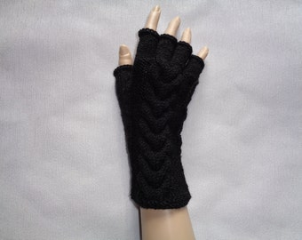 Handknitted black color women fingerless gloves / wrist warmers with cables