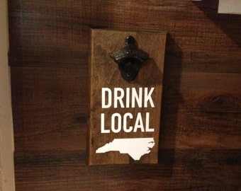Drink Local - Wall Mounted Iron Bottle Opener, Stained Solid Wood Board with Your Choice of Black or White Vinyl Lettering