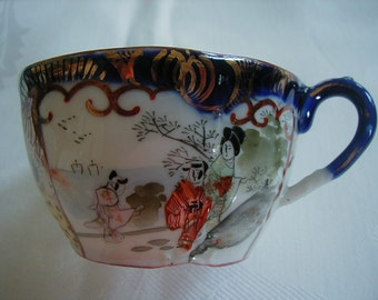 Beautiful cup blues, reds and gold trim wonderful colors.