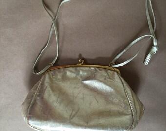 1970s golden leather kiss lock purse