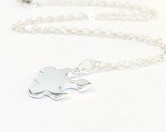 Sterling Silver Charm Suspended on Sterling Silver Chain Necklace