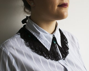 fringe black necklace with green accents