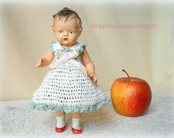 Dollhouse doll girl made of composition, German vintage 1930s, jointed, with molded hair & shoes, 6 3-4 inch standing, crochet dress