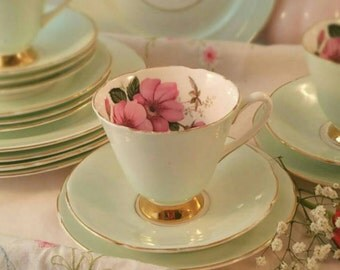 Vintage Royal Sheraton tea cup, saucer and tea plate in pale cream with pink Hedge Rose Pattern. TT090.