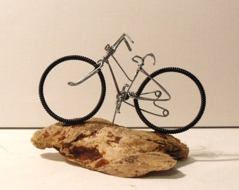 Miniature wire bicycle mounted on Driftwood