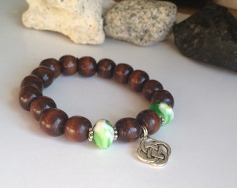 Nice celtic wood beads bracelet with green swirl glass beads