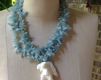 Aquamarine multi strand (3) necklace, silver accents, white coral drop (removable bail), silver chain with lever clasp.