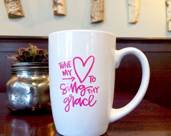 Tune My Heart To Sing Thy Grace mug by laurenish design