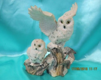 Owls sitting on  branch Figurine   resin. used