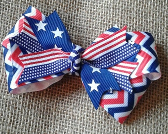 Patriotic red white and blue ribbon bow