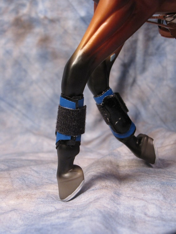 model splint boots for traditional scale horses blue