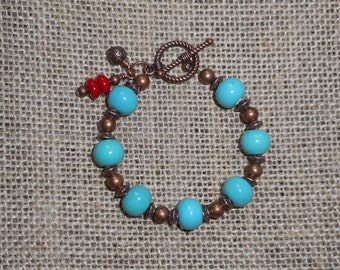 Ceramic beaded bracelet with copper and coral bead accents, turquoise bracelet, coral accents