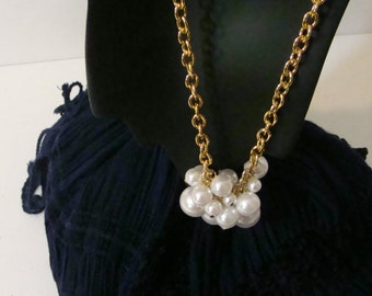 White pearl and gold necklace.