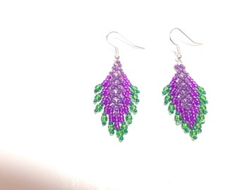Green and purple beaded feather earrings.