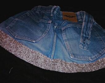 Blue denim half apron with sparkly border.  33 inch (84 cms) waist