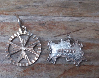 Two vintage silver charms, TLM Jersey map and a Maltese cross