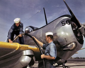 WWII Fighter Plain getting refueled , 1943