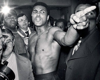 Muhammad Ali finger-pointing during the weigh-in before his second boxing match with Joe Frazier