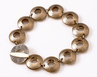 "Bronze Metal Bracelet - Circular Design 1/2"""