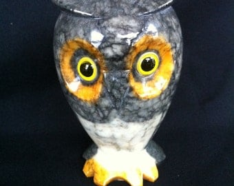 An Owl Figurine That Has A Label That Reads Genuine Alabaster Made In Italy