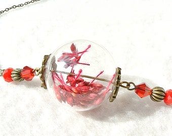 Necklace with red flowers in glass