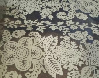 Flocked foil wallpaper