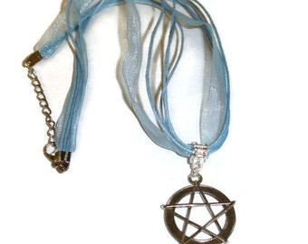 Pentagram Necklace on blue organza