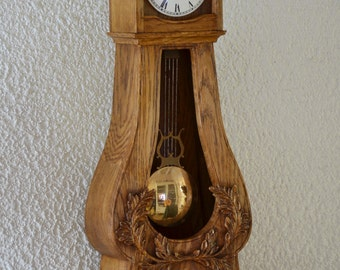 Mini clock comtoise in solid oak