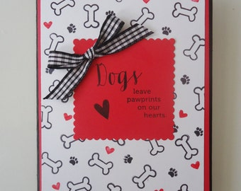 Pet sympathy card - Dogs leave paw prints on our hearts. Personal and loving condolences on a beautiful red and black card. Handmade card.