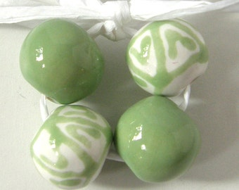 Okawa Ceramic Bead set in green with Tribal pattern