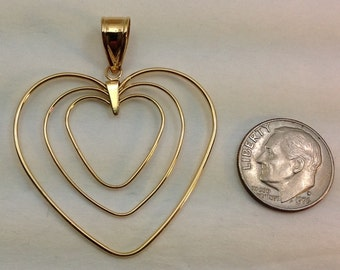 Large 14kt gold heart pendant.