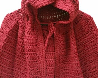 red hooded cape