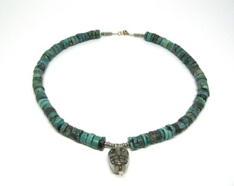 Frida: raw turquoise and large carved pyrite skull necklace