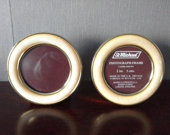 pair of small round picture frames