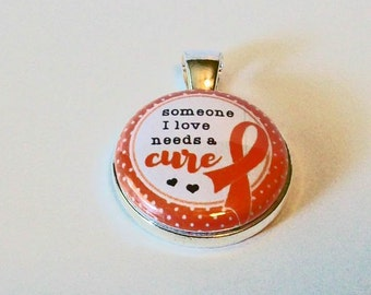 Red Ribbon Awareness Someone I Love Needs a Cure Round Silver Pendant