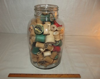 Collection of Over 100 Vintage Empty Wooden Spools in Owens Glass Company Gallon Jar