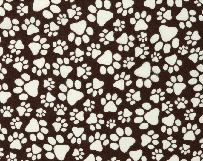 Joann Fabrics.- Snuggle Flannel Fabric - Paw Prints in Brown and Cream