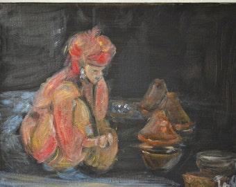 Moroccan young preparing a tagine