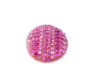 RHINESTONE BROACH -VINTAGE or collectible; medium pink, light pink and dark pink rows, gold color metal, 1.50 inches in diameter