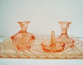 Pink glass vanity set for vintage dressing table