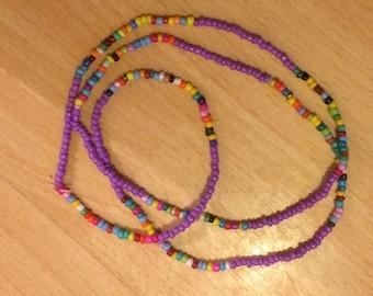 Beaded wrap anklet purple and multi coloured seedbeads with elastic thread. Hippie/boho/festival/beach