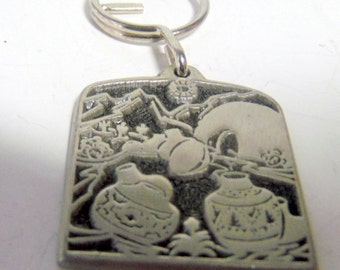Souvenir of the Southwest, Arizona.  Embossed pewter key ring.  Southwest pots.   Very good condition