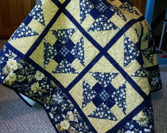 Blue and yellow floral quilt