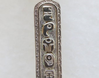 Sterling Silver Long Slender Pendant with Mexican Symbols
